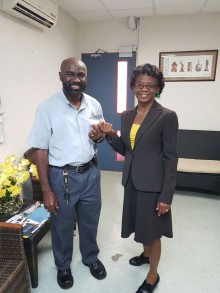 Ist winner of the competition Mr. Kenneth Alleyne accepting his ticket from Mrs. Maxwell