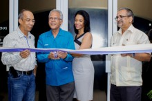Dr Cecil Aird (second left) and his daughter, Daniella at the ribbon-cutting ceremony for the US$250,000 Carnegie Hand Institute and Surgery Centre, at the Whitter Village in Montego Bay, Jamaica. Sharing in the moment are from left: Member of Parliament for North West St James, Dr. Horace Chang and Senior Medical Officer at Cornwall Regional Hospital, Dr. Delroy Fray.