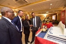 (From left) Pro-Vice Chancellor and Principal, UWI Mona, Professor Dale Webber; Managing Director, Global Public Affairs, Jake Suski; Deputy Principal, UWI, Mona, Professor Ian Boxill and Dean, Faculty of Engineering, Dr Paul Aiken, admire a cake with the logo of the new Faculty of Engineering at the launch, on September 13, 2018.