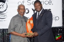 L – R Dr. the Right Excellent and Right Honourable Sir Kenney Simmonds and Craig Tuckett, UWIAA President, St. Kitts and Nevis Chapter