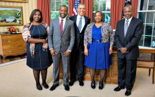 Elizabeth Darius-Clarke with her family as she presented her credentials to President Barack Obama