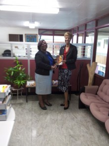 Director of Alumni Relations (right), based at the UWI Regional Headquarters, Celia Davidson Francis, presenting a copy of When Conchi Blows to Ms. Beverley Lashley, Deputy Librarian of the Mona Campus, on behalf of his cousin Robert Vernon, the Executor of the Estate of the author.