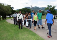 UWI Admissions Student Advocate (ASA) guiding tour participants at the UWI St. Augustine.
