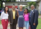 Carina Dyce, Campus Alumni Officer for Mona, Prof. Winston De La Haye, Deputy Dean of the Faculty of Medical Sciences, Celia Davidson Francis, Director of Alumni Relations for the UWI, Dr. Shelly-Ann Fraser-Pryce, UWI Honorary Graduate and Olympian and Pro Vice-Chancellor and Principal of the Mona Campus, Professor Dale Webber at Shelly's Pop Up Café at the Alumni House at Mona.